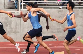 Jeremy Sacristia hands the baton to second runner Bailey Jones in the 4x100.