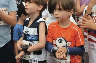 Two boys synchronize their watches before the start of the Kids' Fun Run. Photo: Shelby Pascoe