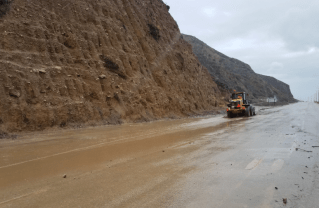 Caltrans personnel clear a mudslide off Pacific Coast Highway in Northern Malibu Monday. Photo: Caltrans.