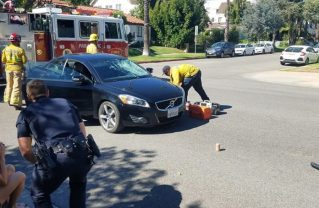 Santa Monica Fire Department personnel respond to an accident involving an e-scooter and a car in October. Photo: Enis Yeneriz.