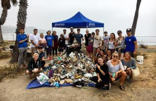 Members of the Surfrider Foundation Los Angeles Chapter with trash collected during a beach clean up at Sunset Point in Pacific Palisades. Photo: Courtesy.