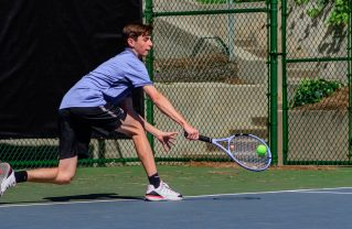Adam Glickman of Pali in stretches for a backhand versus Venice. Photos: Morgan Genser.