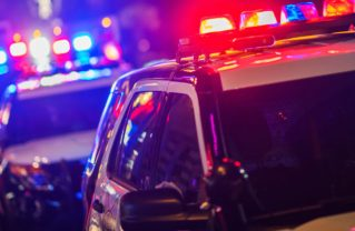 Night Time Police Violent Crime Intervention. Police Vehicles with Flashing Lights.