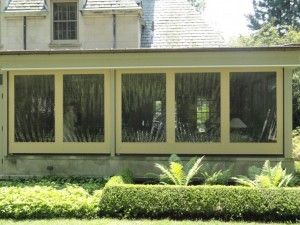 DuraScreen Motorized Retractables are great for enclosing a patio for blocking wind and rain during winter months.
