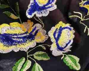 ТканьСетка Сетка-Вышивка стрейтч Купоном на черном фоне