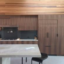 Kitchen Cabinets made with Walnut and Metal Backsplash