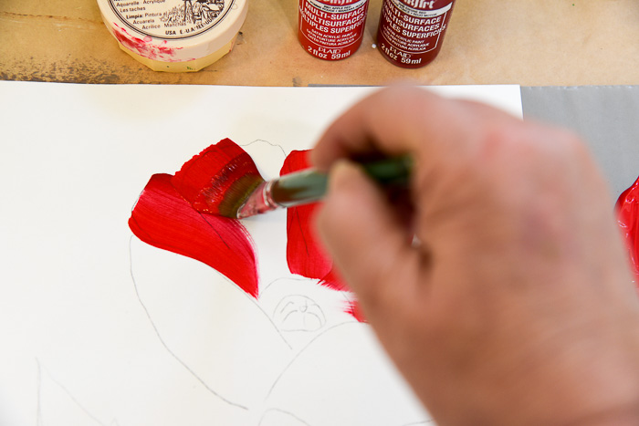 Strokes on how to paint a large red poppy