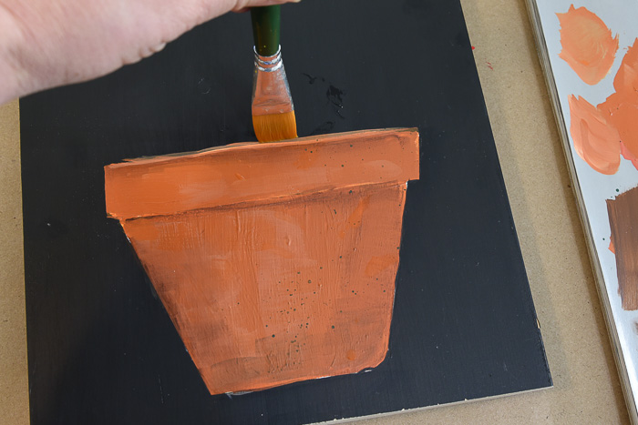Paint a Terra Cotta Pot in acrylics. Painting clay pots is a great way to start a floral painting. I show you how step by step, with video and pattern