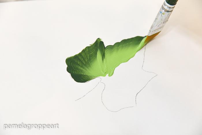 painting a pumpkin leaf in folk art acrylic paints