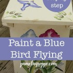 DIY bench painted with flowers and birds with text overlay, pamelagroppe.com