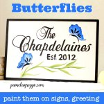 Blue butterflies hand painted on a sign, with text overlay, pamelagroppe.com