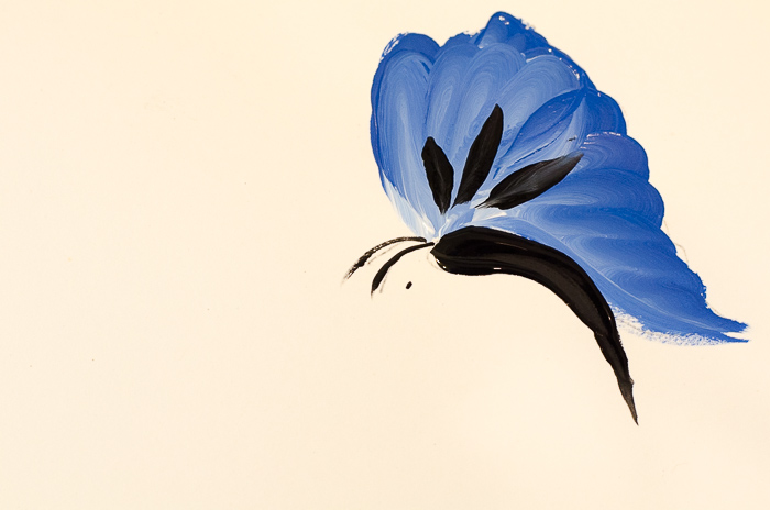 Adding antennae to blue painted butterfly, pamelagroppe.com