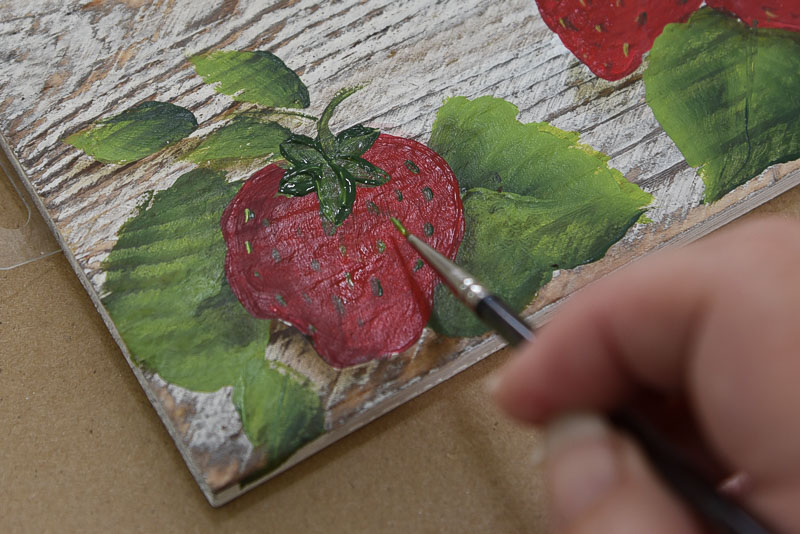 painting on strawberry seeds,