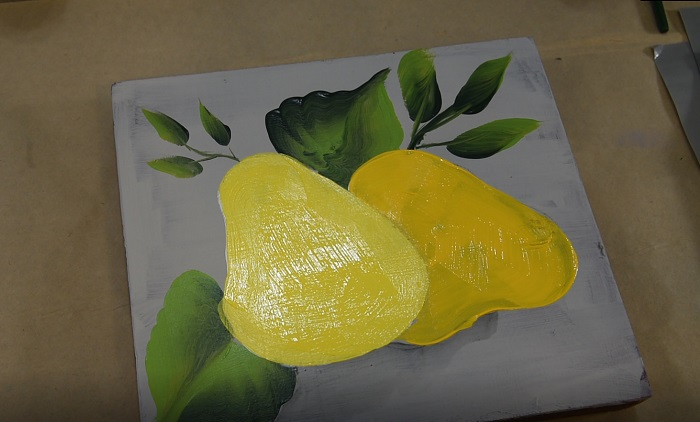 Painting pears base coat in yellows