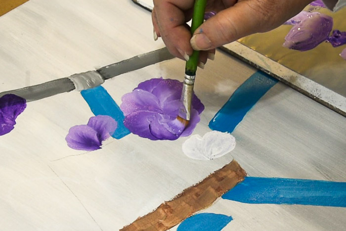 Paint bottom petal of pansy in acrylics