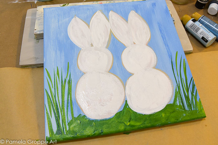 white bunnies painted on a canvas