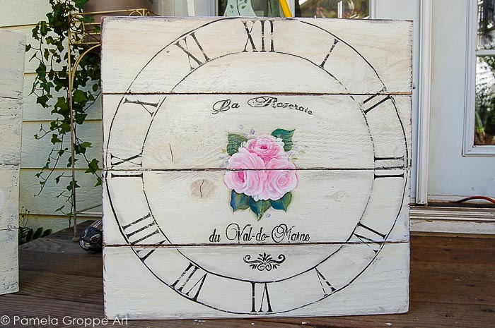 faux vintage clock painted on pallet wood board