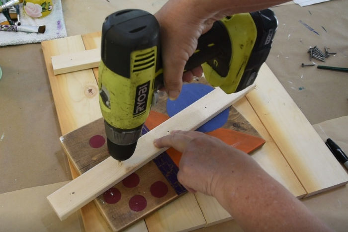 drilling holes in lathing strip for pallet wood board