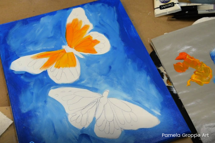 Paint a butterfly, add yellow and orange to wings