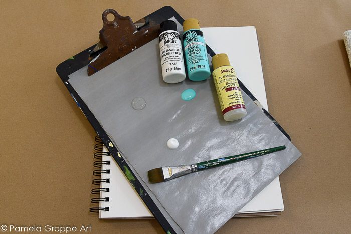 folk art paint, flat brush and palette paper