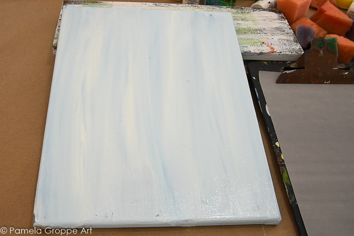 streaky background of warm white and blue on canvas