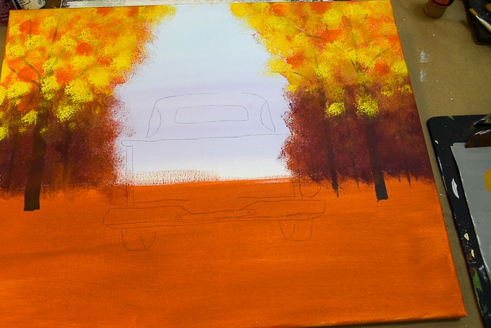 Add lighter yellows to trees in fall truck painting to brighten it up