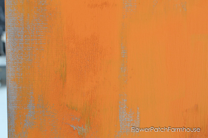 Pine board with painted orange with crackling and distressed.