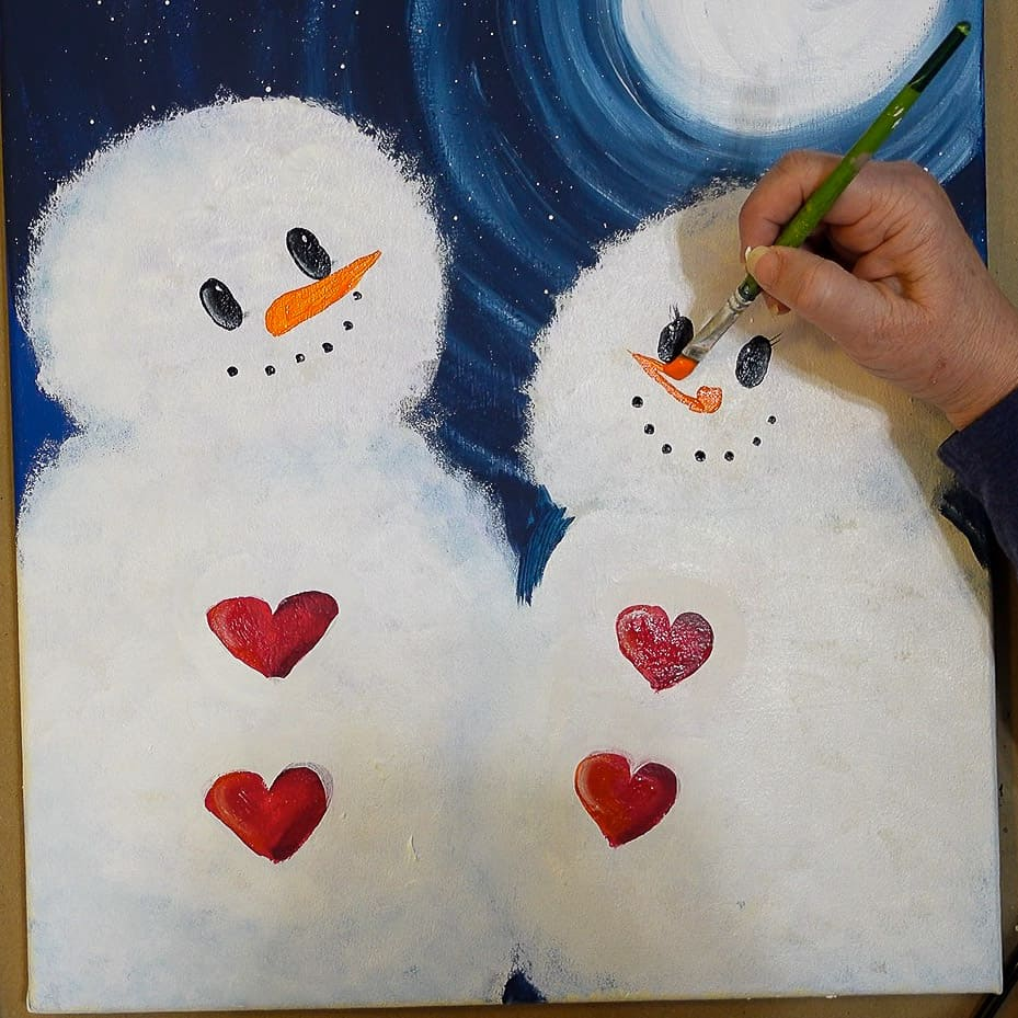 Adding carrot nose with Pure Orange on snow lady