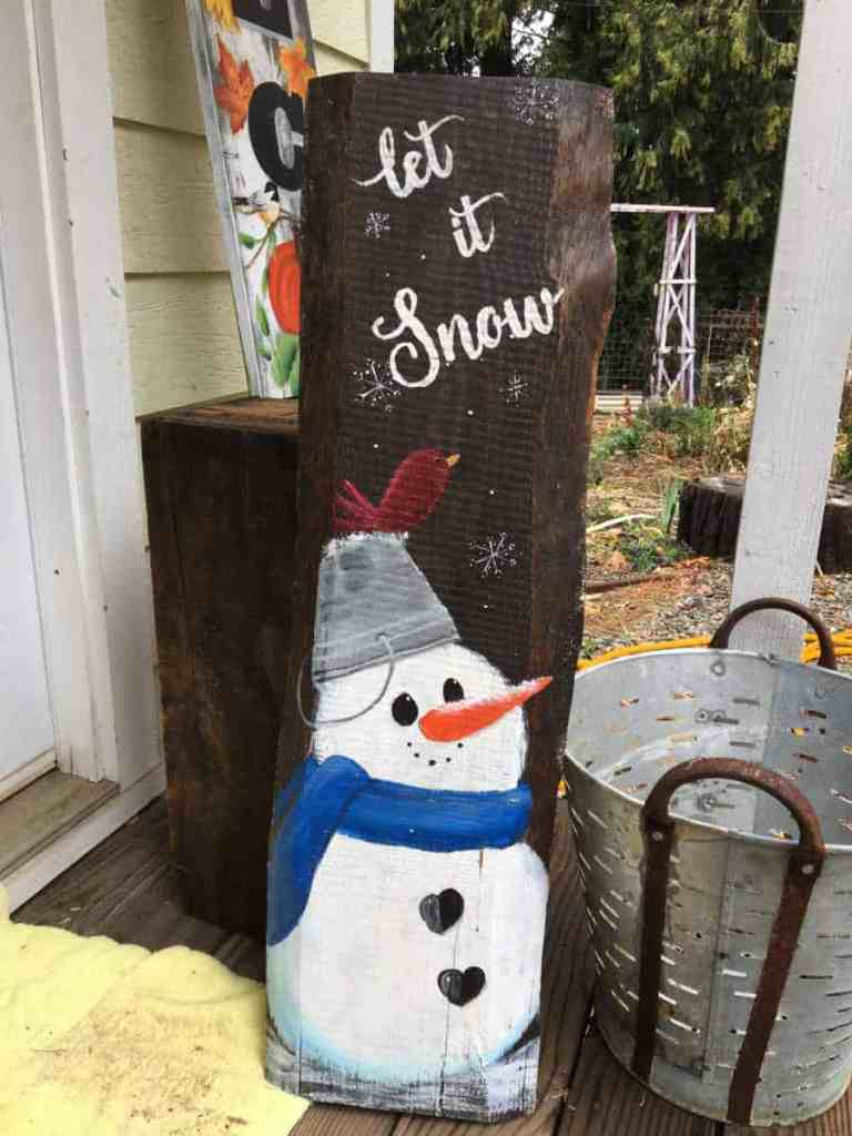 snowman sign painted in acrylics, let it snow
