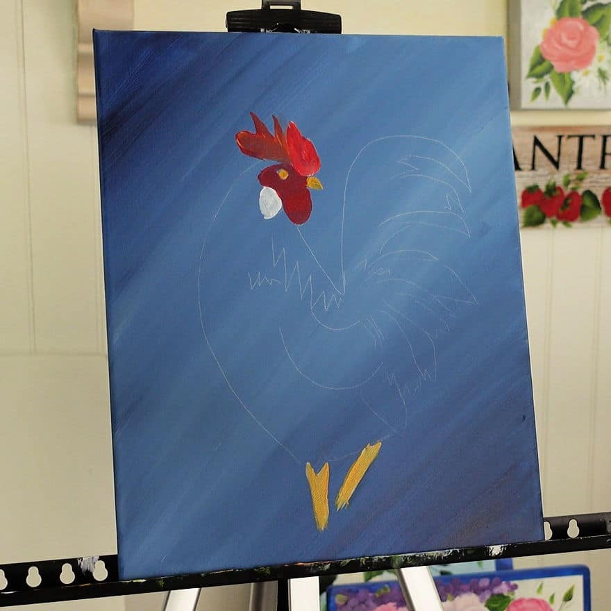 Paint rooster legs and beak with yellow ocher