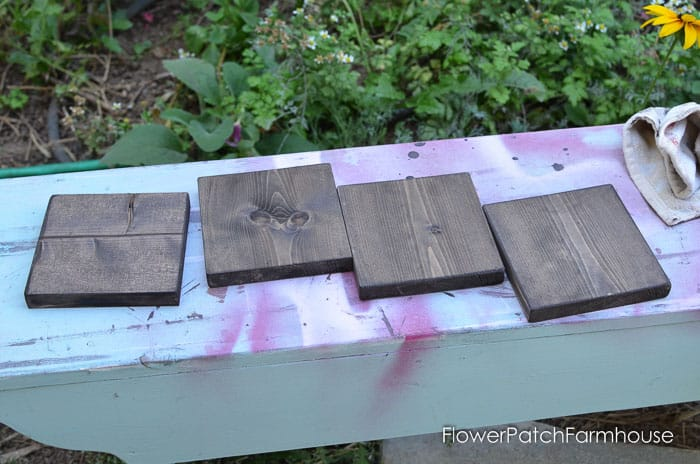 wood squares stained a dark color, pamela groppe art