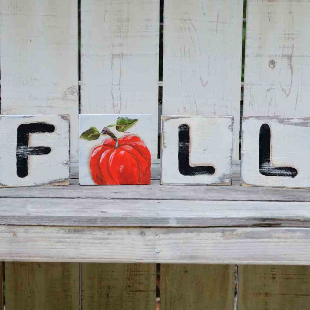 Fall Scrabble Art DIY, Scrabble tiles cut from lumber painted to spell FALL with a pumpkin in place of the A, Pamela Groppe Art