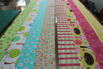 And you end up with two long strips, each of four different materials. Please note these have been pressed neatly. I have my iron out and going the whole time I sew, and press the materials frequently.