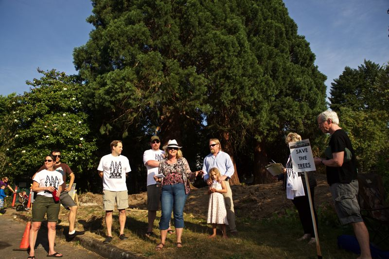 TRIBUNE PHOTO: JAIME VALDEZ - Elizabeth Leach speaks on behalf of neighbors in Eastmoreland about saving three 150-year-old sequoia trees from being cutdown during a Save the Giants Jam.