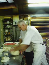Paul on the workbench at client bakery Lighthouse, Northcote Road, Clapham, London