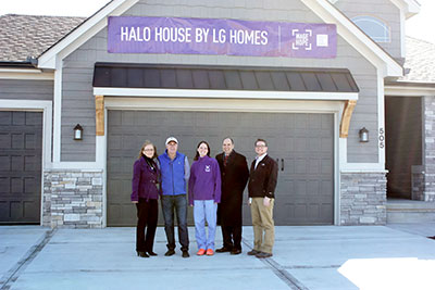 Charlotte Garrett -Donor and Corporate Ambassador, Larry Grego - Owner of LG Homes, Kathy Grayson – Kansas City Affiliate Chair, Brad Lee – Honorary PurplyStride Chair, Jake Coleman – Media Relations Chair standing in front of the second Halo House