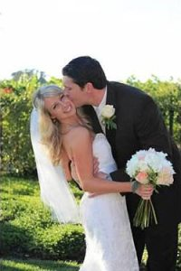 Justen and Katie Meyer seizing the moment on their wedding day.