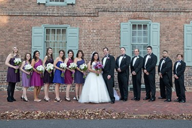 It's time for a purple wedding! David and Lauren Annal with their wedding party.
