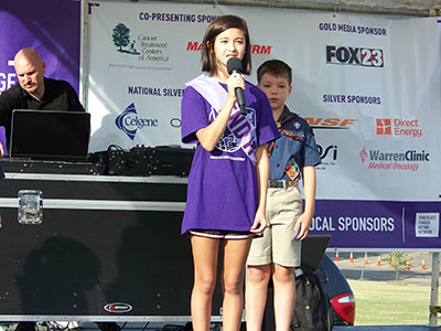 Leon Schneider's granddaughter Jaida performed the National Anthem during PurpleStride Oklahoma opening ceremonies in 2015.