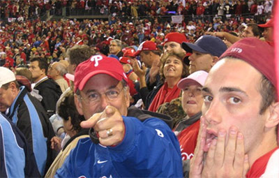 Ethan and his dad playing around for the camera at a Phillies game.