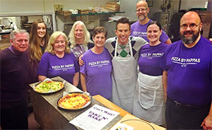 Bill & Tom Sheakoski with employees and volunteers promoting the fundraiser on their local news morning show.
