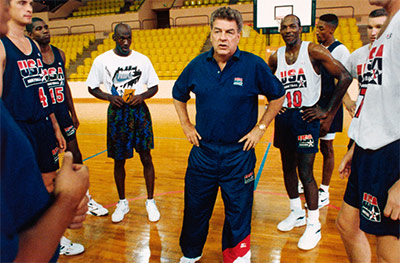 "Chuck Daly in a huddle during practice with the 1992 Olympic ""Dream Team."" (Photo courtesy of si.com)"