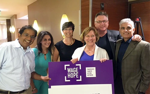 Lynn Matrisian, PhD, MBA, holding sign, with scientific advisors who Wage Hope every day.