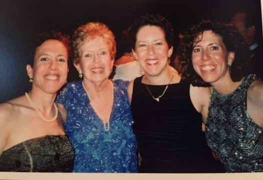 Randi's favorite picture with her mom and two sisters at a wedding. Her mom passed away of pancreatic cancer in 2006.