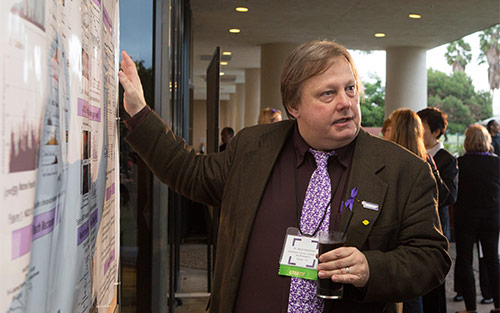 David Boothman, PhD, explains his research focus to volunteers at a Pancreatic Cancer Action Network event.