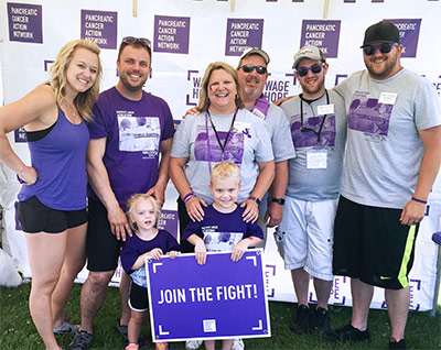 Kara (center) with her family at PurpleStride Denver