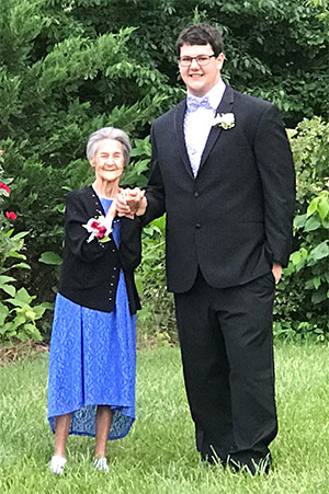 High school junior, Stephen Virgil, holds the hand of his 92-year old grandmother, Julie Jarman, for their prom picture.