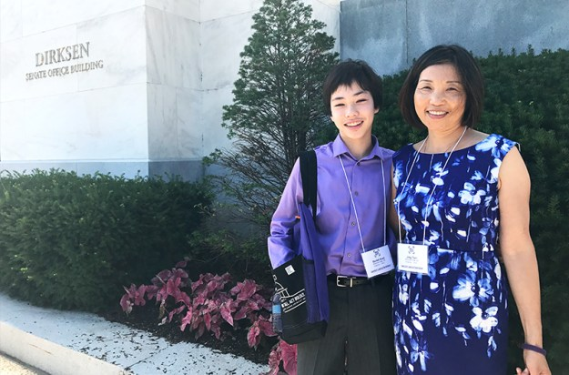 Teen embraces his mom outside of the Dirksen Senate Office Building before meeting with U.S. senators about pancreatic cancer