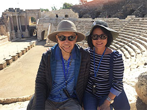 Hector and his wife take a photo at a landmark in Jordan during their travels
