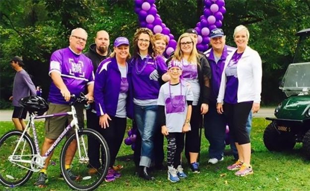 Lisa Beckendorf, a pancreatic cancer survivor and volunteer, at right with friends at PurpleRideStride bike ride and 5K walk.